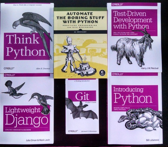 A picture of six Python books that were given as raffle prizes.